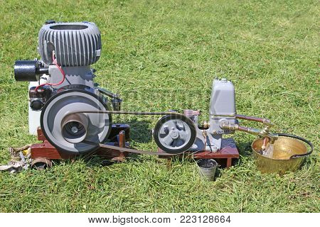 Vintage stationary engine standing in a field