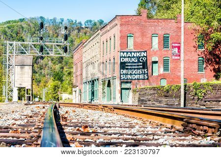 Thurmond, USA - October 19, 2017: Railroad rail junction, abandoned closed buildings with sign in West Virginia ghost town village