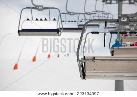 Ski lifts over a snow covered ski slope