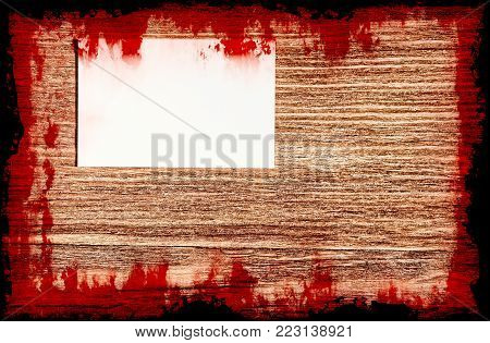Bloody Suicide note on grunge wooden background with black frame.Halloween background.