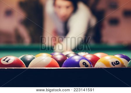 Playing billiard. Billiards balls green billiards table. Billiard sport concept. Pool billiard game.