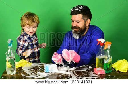 Guy With Beard In Rubber Glove At Table.