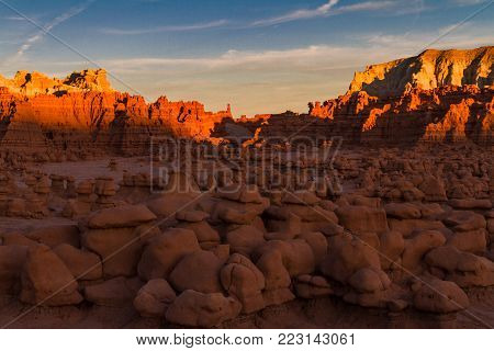 Glowing hoodoos and sandstone mountains of Goblin Valley State Park in Utah USA