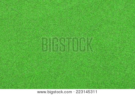 Close up of green synthetical felt textured background