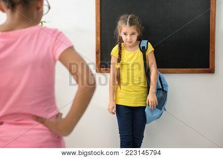 Girl bullying her classmate in school
