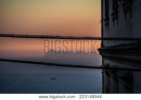 View from Naples of Capri island in between cables