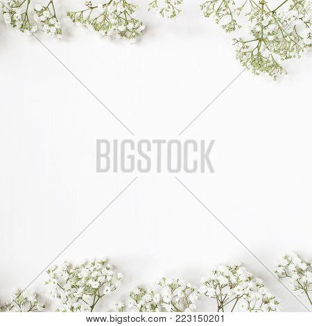Styled stock photo. Feminine wedding desktop mockup with baby's breath Gypsophila flowers on white background.