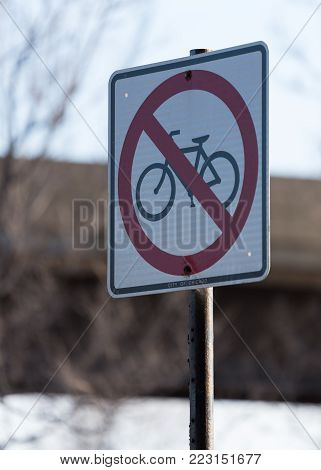 Bikes are not allowed sign on a street
