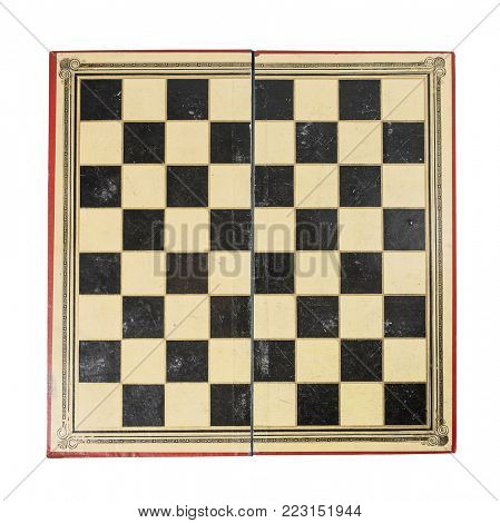 Old and worn antique chess board isolated on whote background