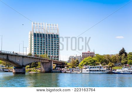 VALDIVIA, CHILE - OCTOBER 30, 2016: View of the Pedro de Valdivia Bridge and Hotel Dreams Pedro de Valdivia. Town is situated on Calle-Calle river.