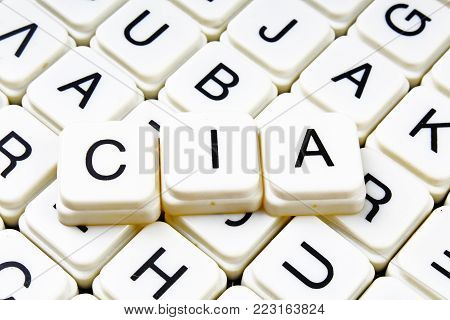 Cia text word crossword title caption label cover background. Alphabet letter toy blocks. White alphabetical letters. Cia.