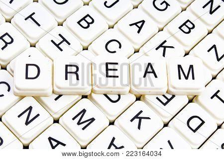 Dream text word crossword title caption label cover background. Alphabet letter toy blocks. White alphabetical letters. Dream