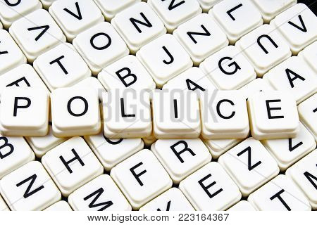 Police text word crossword title caption label cover background. Alphabet letter toy blocks. White alphabetical letters. Police.