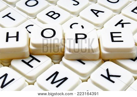 Hope text word crossword title caption label cover background. Alphabet letter toy blocks. White alphabetical letters. Hope.