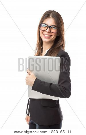 Young nerdy woman with glasses holding a laptop computer and working in tech support
