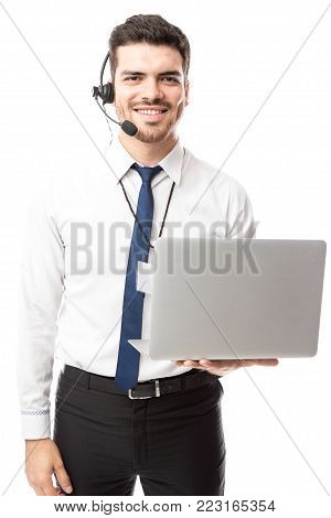 Portrait or a good looking nerdy man with a laptop computer working at tech support in a call center