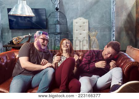 Friendship, threesome ha-ha on sofa, home party
