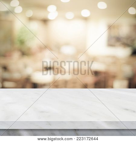 Empty white marble table over blur restaurant background, product and food display montage