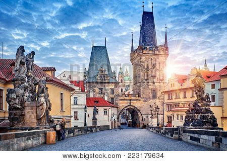 Sunrise on Charles bridge in Prague Czech Republic picturesque landscape morning old Europe with vintage architecture and historical landmark.