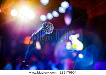 Public performance on stage Microphone on stage against a background of auditorium. Shallow depth of field. Public performance on stage.