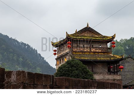 Northern Door Tower in Fenghuang Ancient town, Hunan province, China. This ancient town was added to the UNESCO World Heritage Tentative List in the Cultural category.