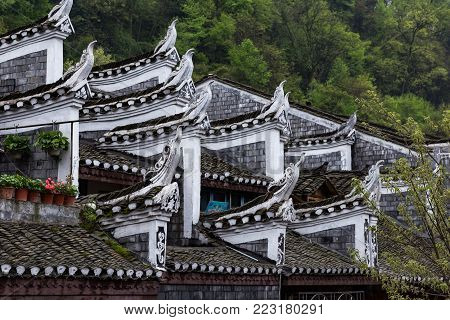 Typical Miao decorations on the roofs of Old Houses in Fenghuang Ancient town, Hunan province, China. This ancient town was added to the UNESCO World Heritage Tentative List in the Cultural category.
