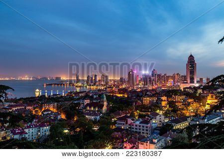 Qingdao Bay and the Lutheran church seen from the hill of Signal Park at evening, Qingdao, China
