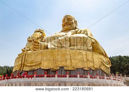 Big golden statue of Buddha in Qianfo Shan, also called mountain of the one thousand buddha, Jinan, Shandong Province, China
