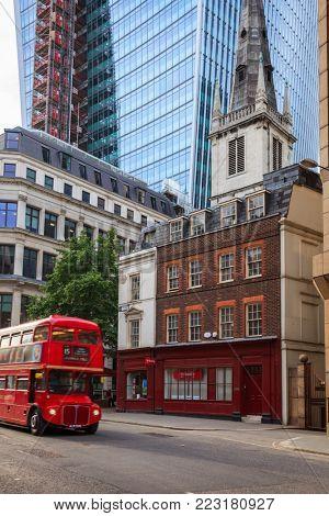 LONDON, UK - JUNE 18, 2013: Vintage Red Double Decker bus moves along the Eastcheap Street, City of London