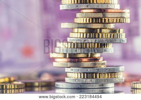 Euro Coins Stacked On Each Other In Different Positions. Money Concept.