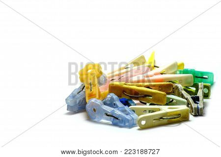 Colorful pegs old isolated on white background