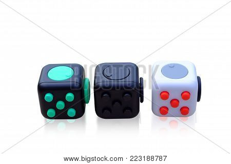 Fidget Cube stress reliever, fingers toy on background. (relax)