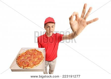 Teen pizza delivery boy making an ok gesture isolated on white background