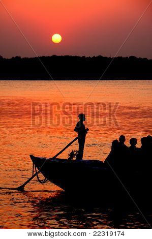 Boat across the river at sunset