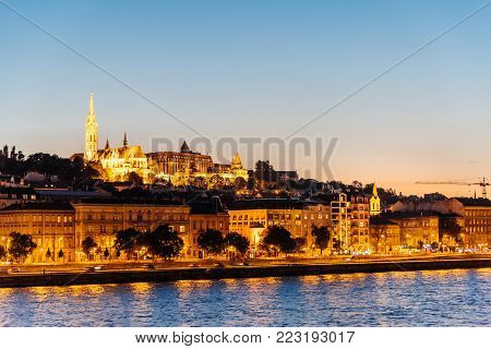 Cityscape of Buda Castle and Danube River in Budapest at night.