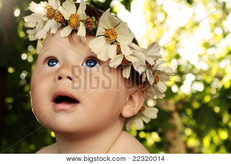 Baby with a wreath