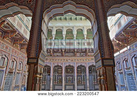 NAWALGARH, RAJASTHAN, INDIA - DECEMBER 25, 2017: Poddar Haveli with colorful frescoes, paintings and columns