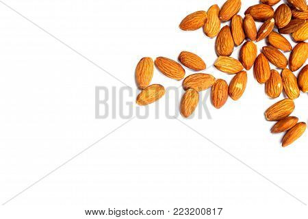 Almonds on a white background. Pile of selected almonds close up. Vega food, isolated