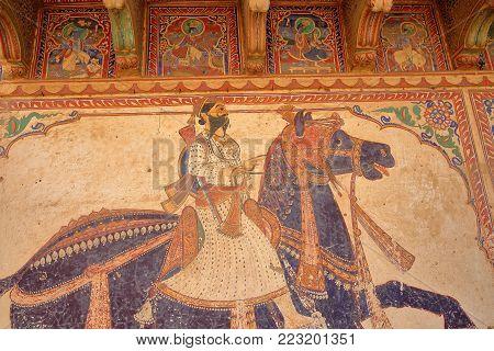 MANDAWA, RAJASTHAN, INDIA - DECEMBER 27, 2017: Details of the mural paintings at Goenka Double Haveli