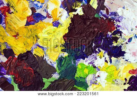 Bright palette of artist, texture of mixed oil paints in different colors, contrasting mix stains, splashes, texture for modern creative background