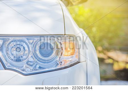 tail lamp of the car.orange light turn signal before turn vehicle to the left direction.safty drive concept without accident