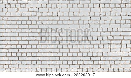 Old grunge brick white wall background with vertical crack