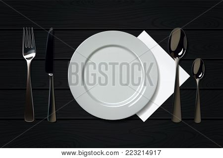 Empty realistic plate with spoon, knife and fork on a wooden background. Cutlery on a wood table.