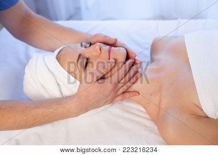 girl masseur doing massage neck face spa health 1