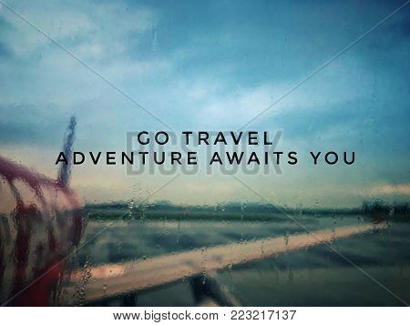 Motivational and inspirational quotes - Go travel. Adventure awaits you. With blurred vintage styled background. poster