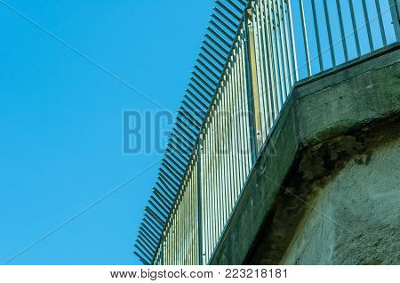 Prision Fence Wire. Concrete built structure for backdrop with copy space