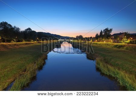 green quay by Nisava river at twilight in Pirot town, Serbia
