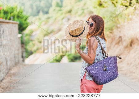 Summer portrait of young woman with hat outdoor