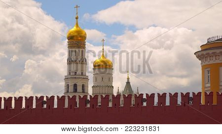 Ivan the Great bell tower behind the Kremlin wall Moscow