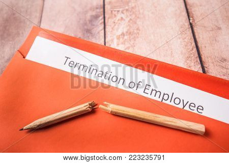 Notice of dismissal and a broken pencil on a red envelope